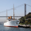 Stock Photo: Traditional sailing ship in front of Bosphorus bridge in Istanbul