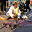 Snake charmer at Djemaa el Fna square in Marrakesh — Stock Photo
