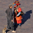 Waterseller and man with monkey, Djemaa el Fna square in Marrakesh — Stock Photo