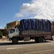 Stock Photo: Truck in front of old city wall of Fez, Morocco