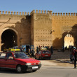 Stock Photo: Petit Taxi in front of old city wall of Fes, Morocco