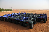 Quad bikes in the Desert near Dubai waiting for tourists. — Stock Photo
