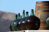 Wine bottles in a winery on Canary Island Lanzarote, Spain — Stock Photo