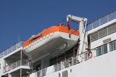 Lifeboat on a davit at a modern ferry ship — Stock Photo