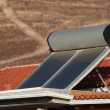 Stock Photo: Water heating solar panels on the roof