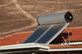 Water heating solar panels on the roof — Stok fotoğraf