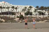 Senior couple doing gymnastics outside of the hotel on Canary Island Fuerte — Stock Photo
