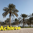 Slogan Achieve on the corniche of Doha, Qatar. — Zdjęcie stockowe