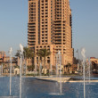 Royalty-Free Stock Photo: Highrise building and fountain at The Pearl in Doha, Qatar