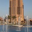 Highrise building and fountain at The Pearl in Doha, Qatar — Stock Photo #8770121