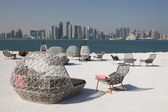 Cafe chairs with view of Doha downtown skyline, Qatar, Middle East — Stock Photo