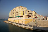 Waterside building of Qanat Quartier at The Pearl in Doha, Qatar — Stock Photo