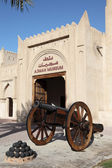 Old cannon in front of the museum of Ajman, United Arab Emirates — Stock Photo