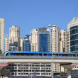 Metro train downtown in Dubai - Stock Photo