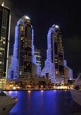Blue illuminated skyscrapers at Dubai Marina — Stock Photo