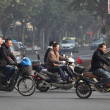 Traffic in Shanghai, lots of are using electric scooters - Stock Photo