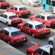 Stock Photo: Taxis in street of Hong Kong.