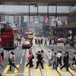 Pedestrians walking over the street in Hong Kong — Stock Photo