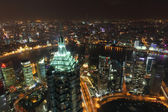 Aerial view over the city of Shanghai at night — Stock Photo