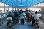 Moped rider waiting for the ferry, Shanghai, China — Stock Photo