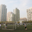 Young playing soccer, Shanghai China - 图库照片
