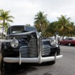 Vintage Car in Miami Beach Art Deco District Ocean Drive, Florida - Stok fotoğraf