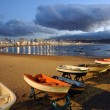 Fishing boats on the beach. Las Palmas de Gran Canaria, Spain - Stock Photo