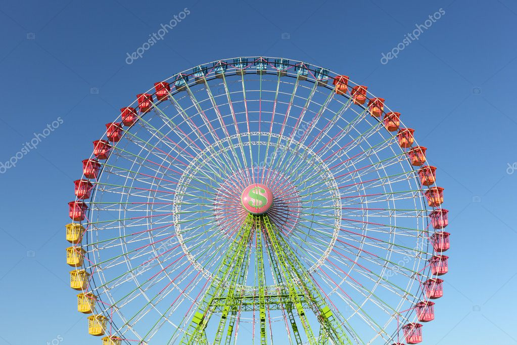 Ferris wheel on a sunny day — Stock Photo #9342982