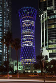 Blue illuminated QIPCO Tower in Doha, Qatar — Stock Photo