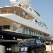 Stock Photo: Bentley convertible parked in front of luxury yacht in Saint Tropez, France