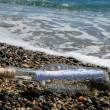 Message in the bottle on the beach — Stock Photo #9453542