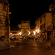 Street in Arles illuminated at night, France — Stock Photo