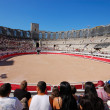 Stock Photo: Spectators of bullfight in Romarenof Arles, France