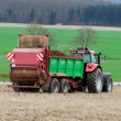 Tractor manuring the field - Stock Photo