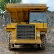 Stock Photo: Big dumper truck in stone pit