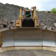 Huge bulldozer in a stone pit — Stock Photo #9455039