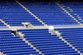 Blue seats in a stadium — Stok fotoğraf