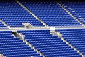 Blue seats in a stadium — Stock Photo