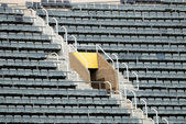 Grey empty seats in a stadium — Stock Photo