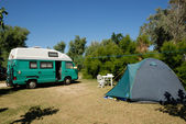 Small european motorhome parked at campsite in France — Stock Photo