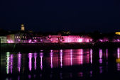 Streetlights reflecting in river Rhone at Arles, southern France — Stock Photo