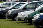Cars parked on the meadow — Stock Photo