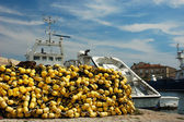 Yellow flew and a trawler in the harbor — Stock Photo