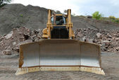 Huge bulldozer in a stone pit — Stock Photo
