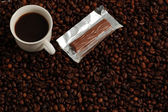 Cup of Coffee with a sweet praline — Stock Photo