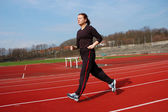 Teenage Girl Running in a Stadium — Foto Stock