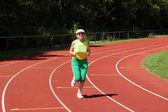 Active senior woman running — Stockfoto
