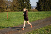Young Woman Jogging — Stock Photo
