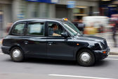 Traditional black cab in London, UK — Stock Photo