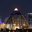 Pyramid shaped WAFI Mall in Dubai City illuminated at night — Stock Photo